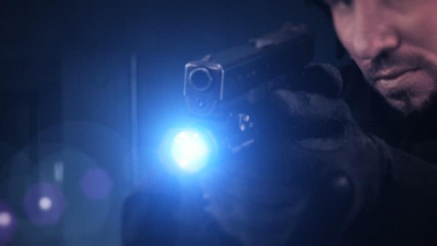 SWAT members in full uniform advancing in dark urban scene. - HD stock footage clip