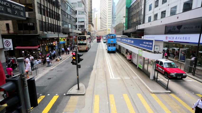 HONG KONG, CHINA - CIRCA JUNE 2014: City view from the Hong Kong double-decker tram. Hong Kong Tramways is a tram system, being one of the earliest forms of public transport in the metropolis.