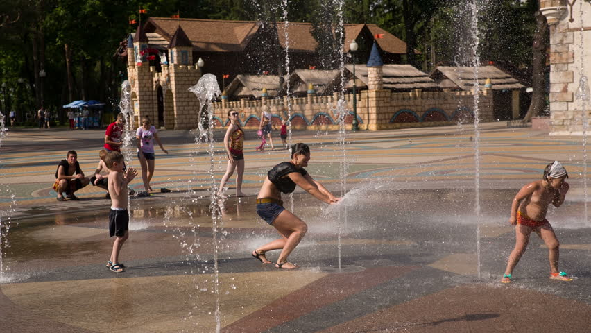 KHARKOV, UKRAINE- 25 June 2014:children and young people having fun in a city fountain - HD stock video clip