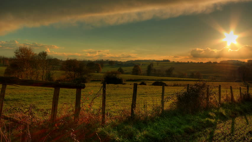 Sunset over green fields, hd motion control time lapse clip, high dynamic range imaging