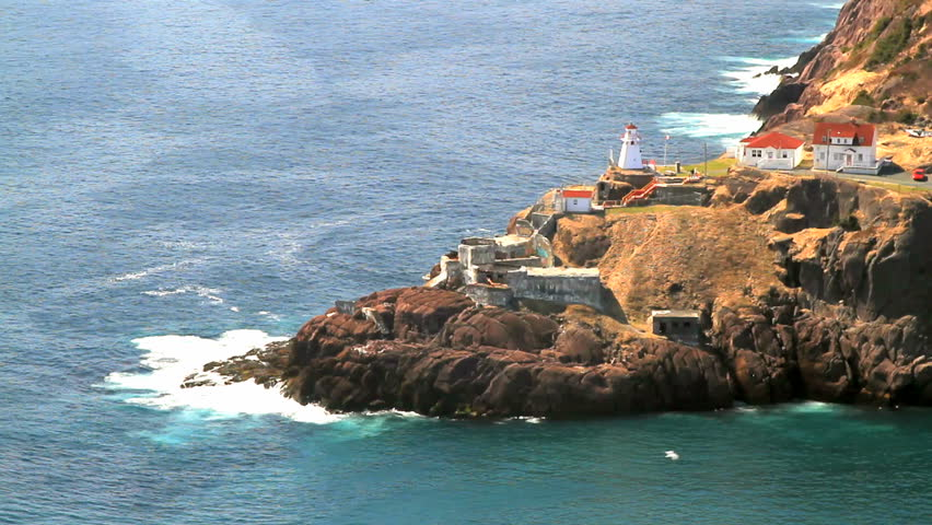 Aerial view of First in Newfoundland Lighting House, Canadian National Historical Site Fort Amherst, ruins of built in WWII bunkers for protection of St. John's Harbor from German U-boats
