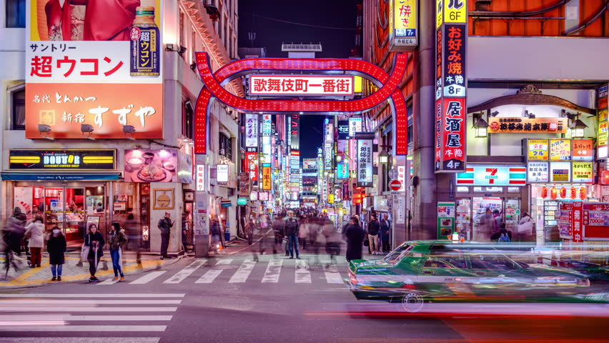 TOKYO, JAPAN - MARCH 14, 2014: Traffic in Kabuki-cho district of Shinjuku Ward. The area is a renown nightlife and red-light district. | Shutterstock HD Video #6802543