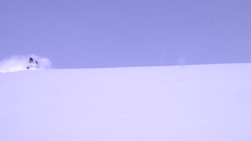 Washington, Utah, Alaska, Oregon, Wyoming, 2012. Skier ski's down a steep slope in slow motion - HD stock footage clip