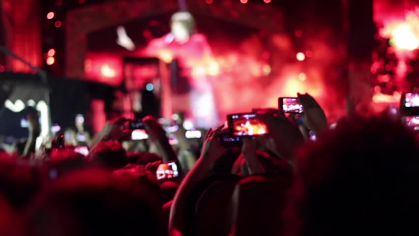 Euphoric crowd making a video and photo with smartphone and tablet. | Shutterstock HD Video #6833188