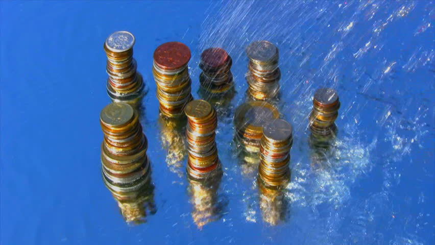 Water falls on top of a pile of metal coins - HD stock footage clip