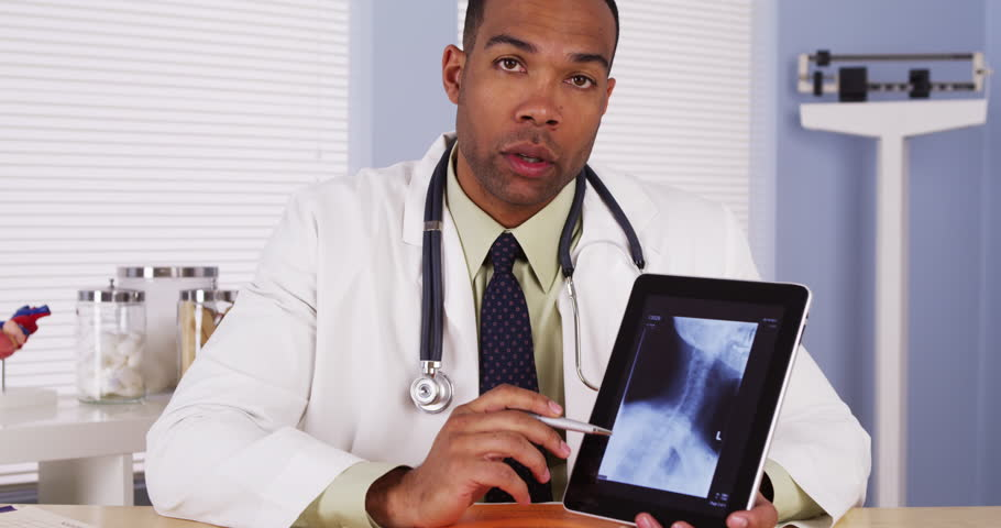 African doctor talking with x-ray on tablet | Shutterstock HD Video #6859711