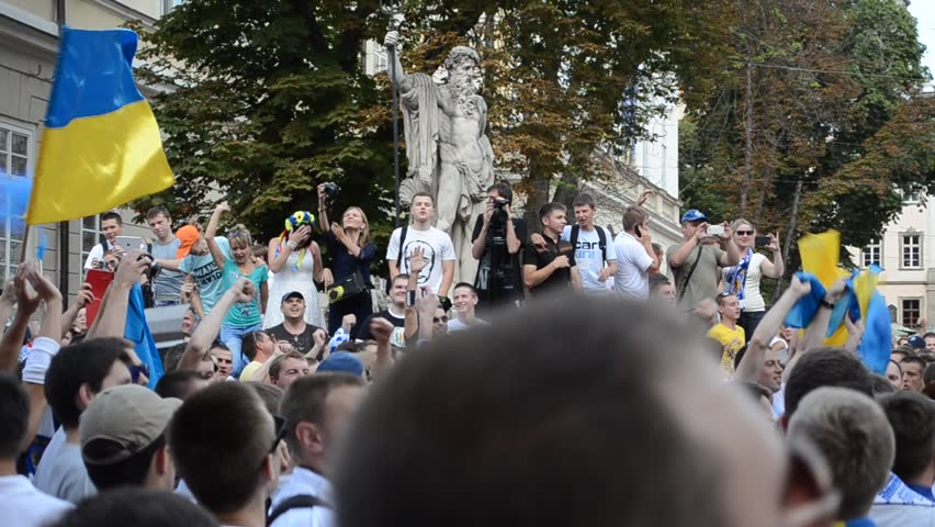 LVIV, UKRAINE - JULY 22: Unknown fans of soccer sing anti-Russian and against V.Putin songs in connection with military aggression of Russia against Ukraine in the Ukraine on July 22, 2014 in Lviv.