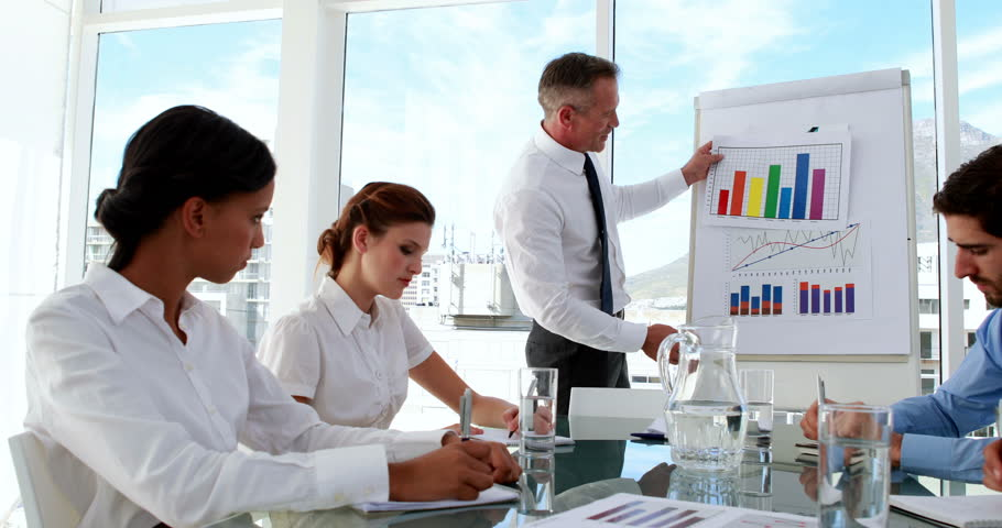 Business manager presenting data to his staff in the office