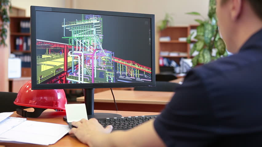 Rear view of engineer worker sitting on working place and making 3d model on pc | Shutterstock HD Video #6875281