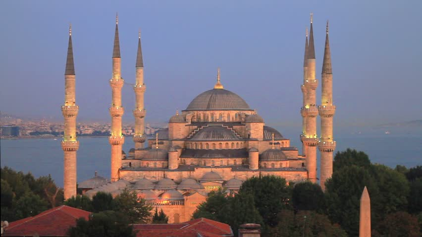 Prayer Time in Istanbul. Pan from Blue Mosque to Hagia Sophia at Sultanahmet, Turkey