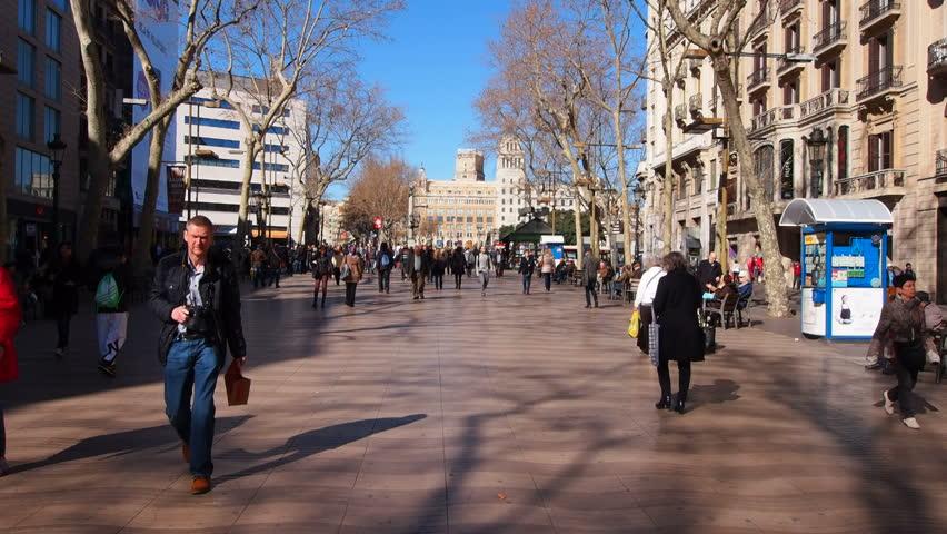 BARCELONA, SPAIN - FEBRUARY 6, 2014: Unidentified people walking on La Rambla in Barcelona, Catalonia, Spain - HD stock footage clip