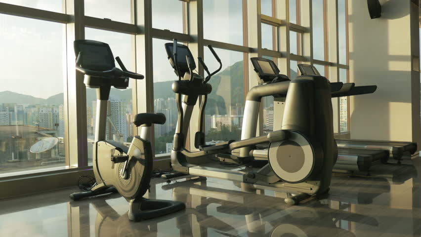 Gym room modern with exercise equipments and