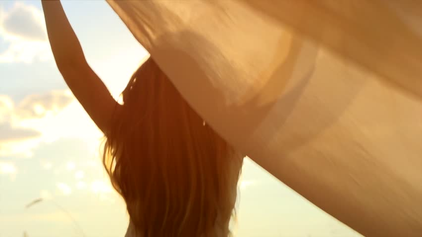 Beauty girl running on yellow wheat field. Freedom concept. Happy woman outdoors. Harvest. Wheat field in sunset. Slow motion 240 fps. Slowmo. 1080p full HD video footage
