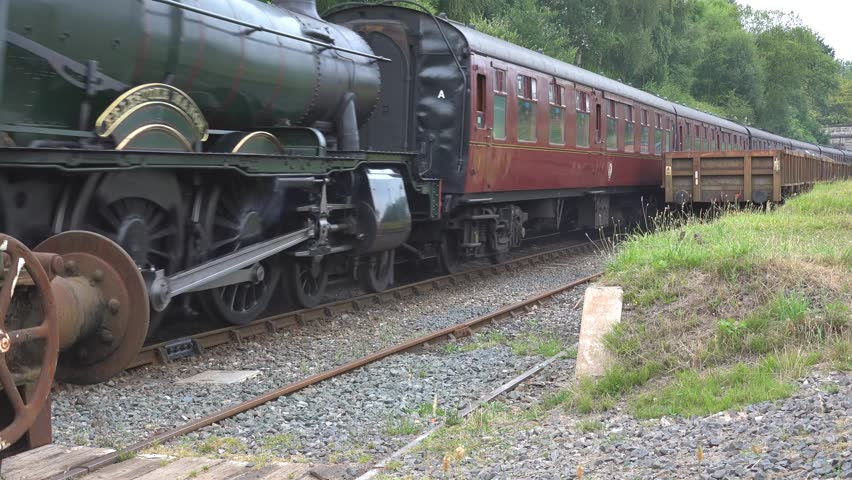 SEVEN VALLEY RAILWAY, HIGHLEY, SHROPSHIRE ENGLAND - 30TH JULY 2014:  Transportation Steam Locomotive Train No. 7812 Erlestoke Manor and carriages with audio  - 4K stock video clip