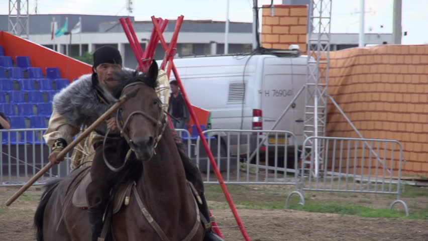 ASTANA, KAZAKHSTAN, July 6 2014, 16th anniversary of the Capital. Duel Riders. Two riders imitate medieval duel on spears. Slow Motion at a rate of 240 fps - HD stock footage clip