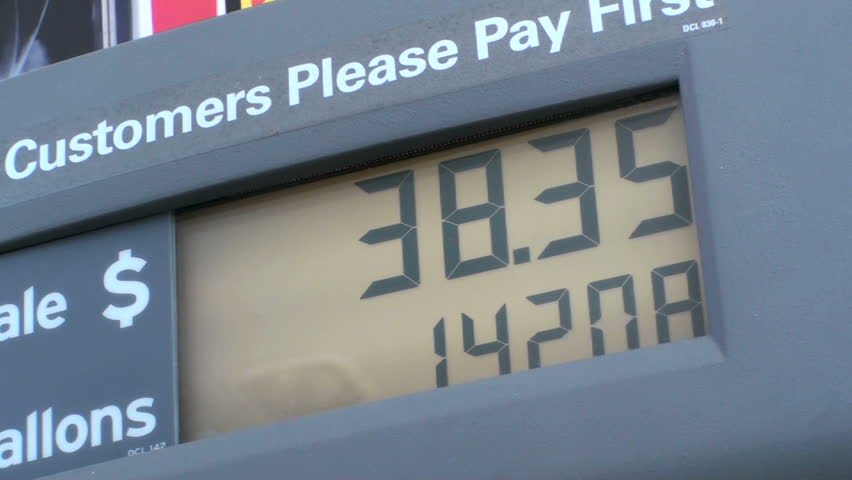 Gas station pump counter shows rising fuel costs. 1920x1080 - HD stock footage clip