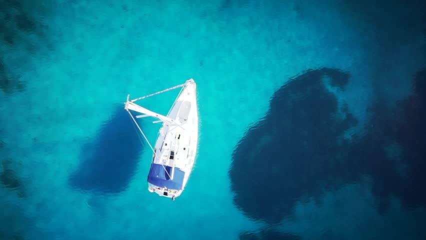 Yacht in amazing clear sea / ocean - water - taken from top by drone | Shutterstock HD Video #7029703