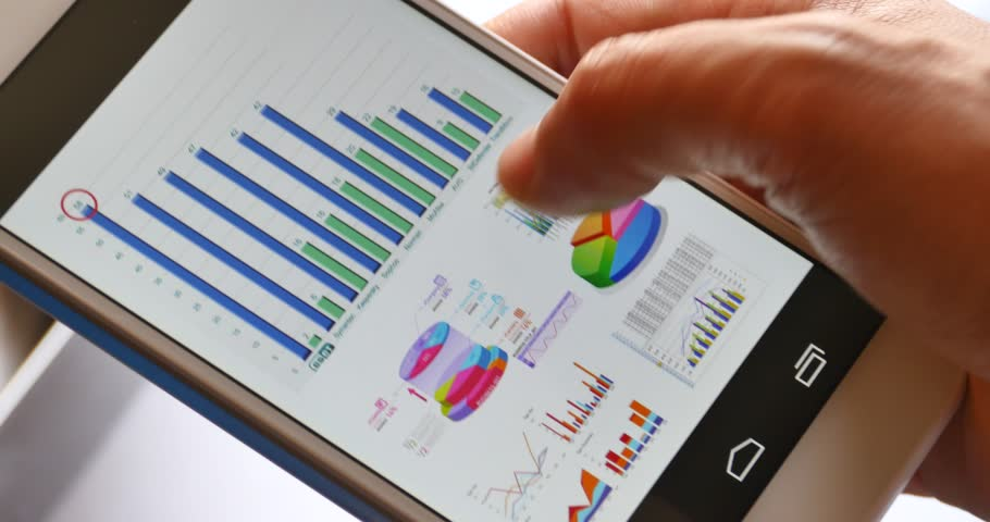 4k Businessman browsing financial news on Mobile Cell Phone,finger touching finance pie charts. gh2_08574_4k | Shutterstock HD Video #7041574