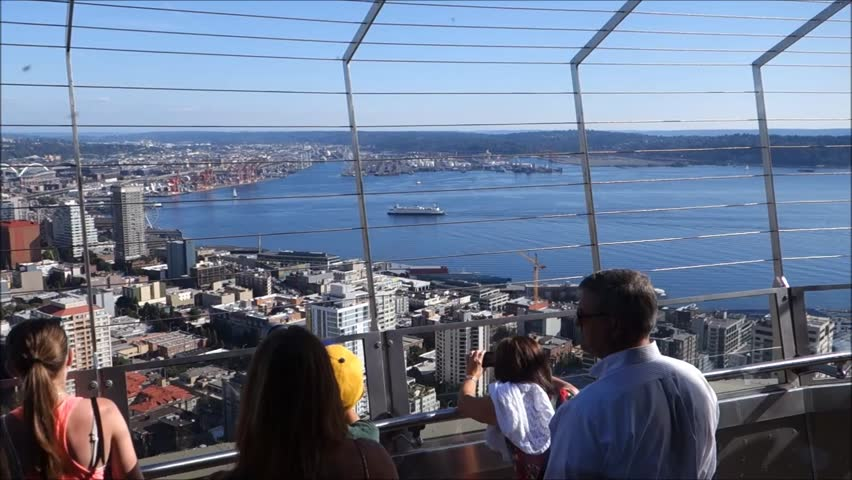 SEATTLE, WA - AUGUST 7, 2014: People at top of Space Needle looking at city below - HD stock footage clip