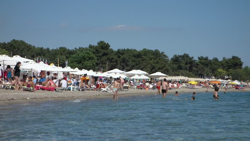Alexandroupolis Greece  city pictures gallery : ALEXANDROUPOLIS, GREECE JULY 7, 2014: Crowded summer beach at a ...
