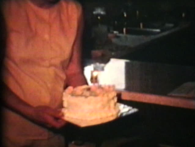 A cute little girl gets a lovely cake on her second birthday only to have her older brother blow out the candle first.  - SD stock video clip