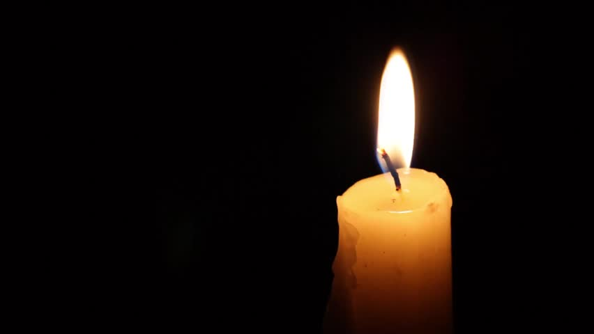 burning candles, candles on a black background