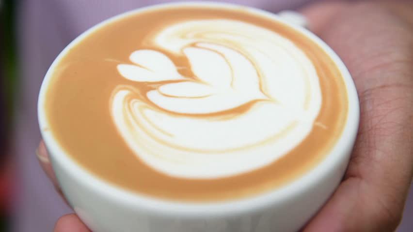 A cup of latte art coffee | Shutterstock HD Video #7164442