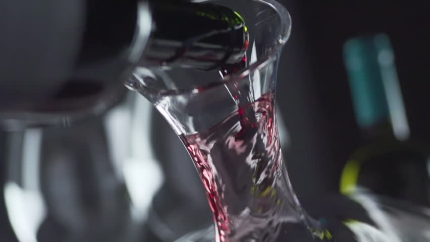 Slow motion wine is poured decanter