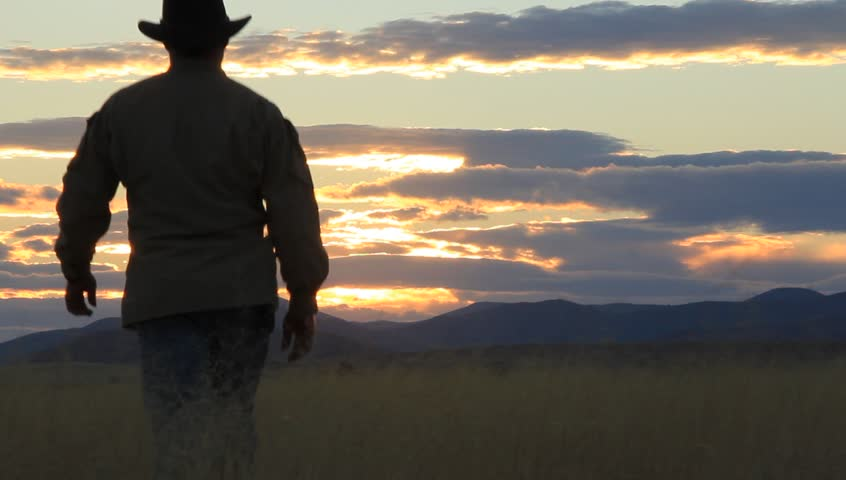 Rancher Surveys His Ranch at Sunset