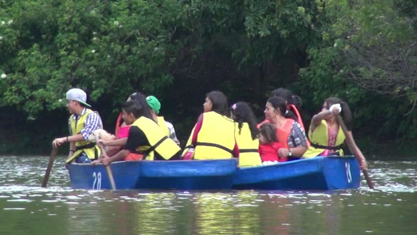 BOGOTA, COLOMBIA  FEBRUARY 17 2014: Friends Rowing on a Lake on February 17 2014 in Bogota, Colombia - HD stock video clip