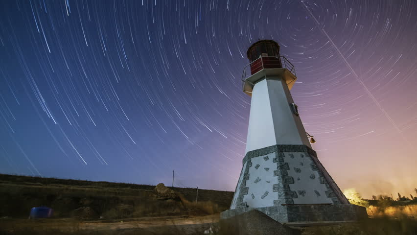 Lighthouse At Night Sky Background -moving Stars Time ...