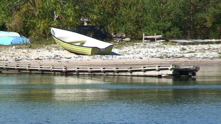 Boat on a small beach - HD stock footage clip