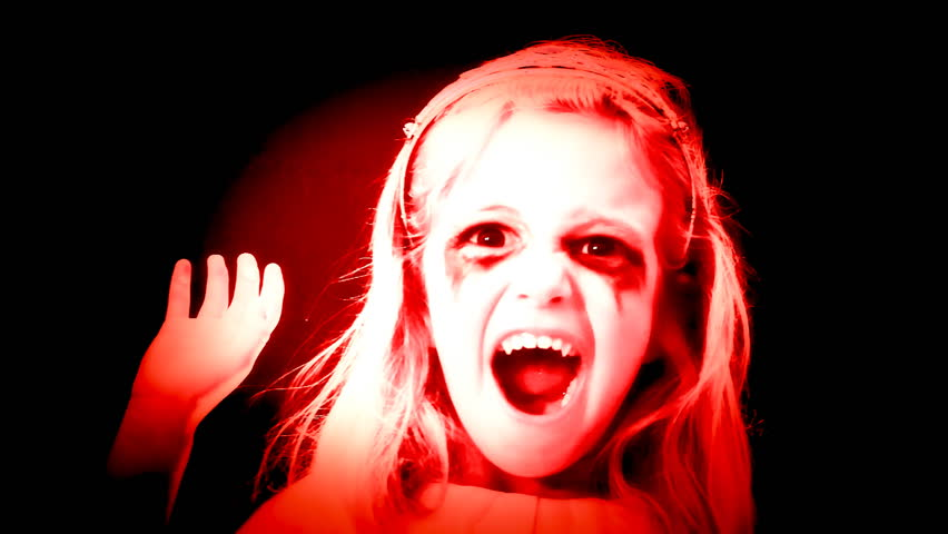 A little girl acting as a scary zombie. | Shutterstock HD Video #7264459