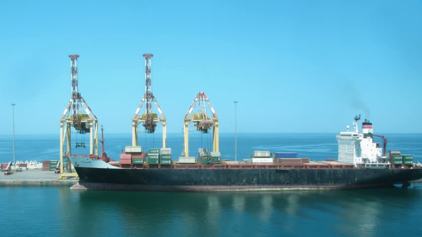 Loading of cargoes on the cargo ship on sunny day. Time lapse.  - HD stock video clip