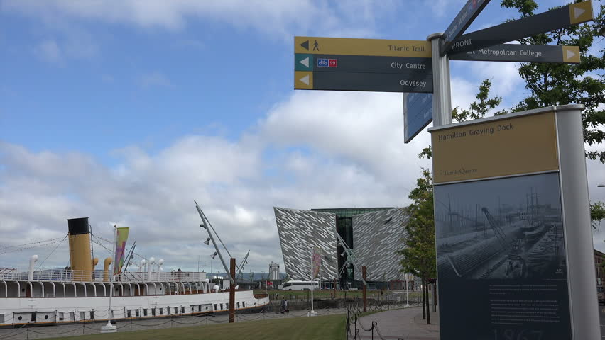 BELFAST, COUNTY ANTRIM/NORTHERN IRELAND - JULY 28, 2014: Zoom into tourist sign posts at Titanic Belfast visitor centre. This visitor attraction and monument is to Belfast's maritime heritage. | Shutterstock HD Video #7283728