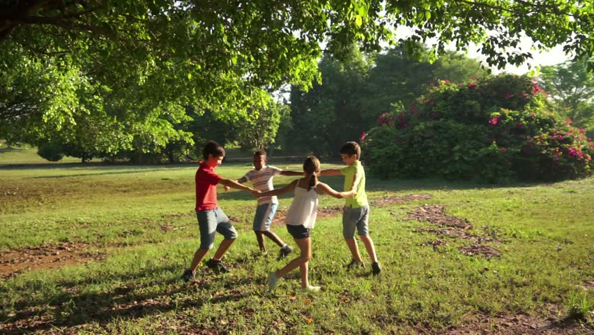 Hispanic and african american little boys and girls playing ring around the rosie in public park and holding hands. Young kids, friends, people, recreation, summer camp fun. 6of18 - HD stock footage clip