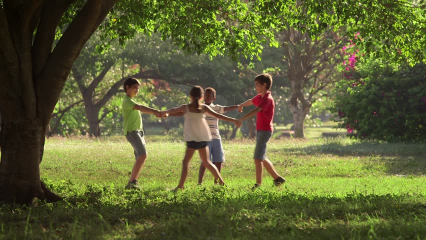 Group of hispanic and african american little boys and girls playing ring around the rosie in public park and holding hands, young people, children having fun. 16of18 - HD stock footage clip