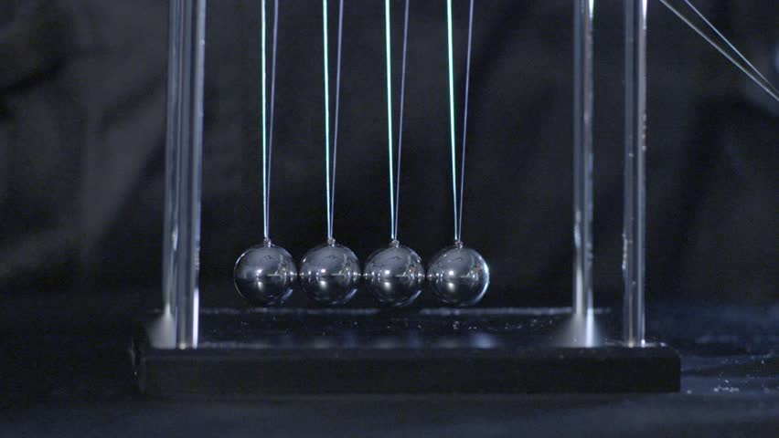 Newton's Cradle, Desk toy pendulum, slow motion, black background - HD stock footage clip