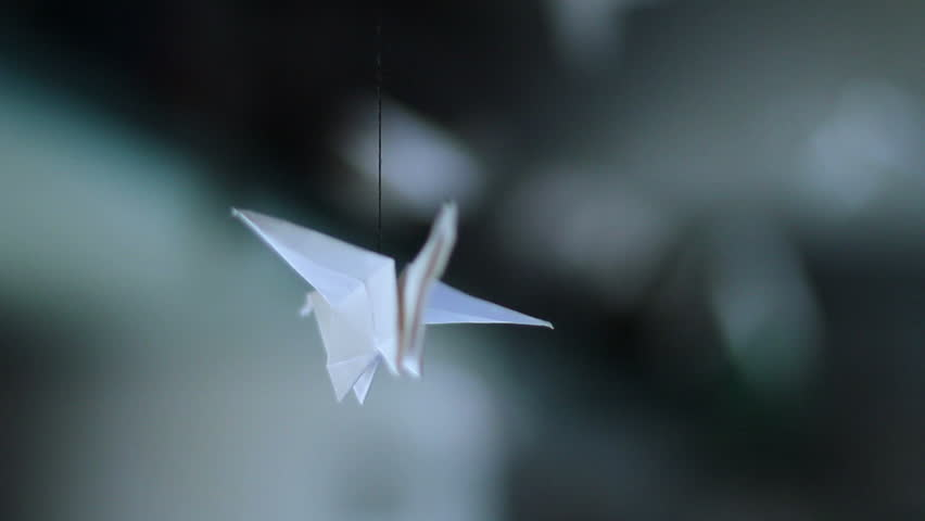 Origami bird spinning around, handmade, Japanese art of paper