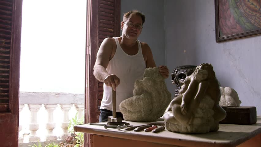 Men and professions, people and jobs, craftsman at work in his atelier, portrait of sculptor holding hammer, using tools and equiopment, and leaning on statue. 4of4 | Shutterstock HD Video #7331176