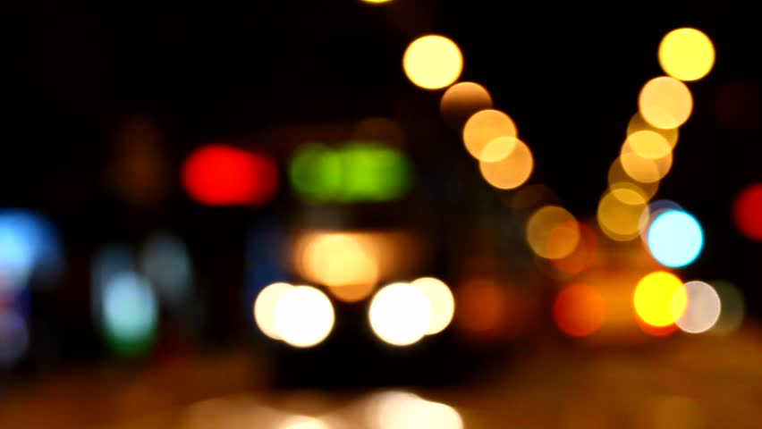 beautiful colorful and bright bokeh lights in the night city, city traffic, abstract
