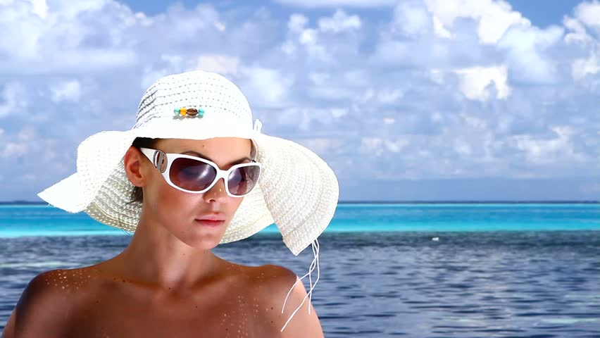 Beautiful woman resting near water at Maldives  - HD stock footage clip