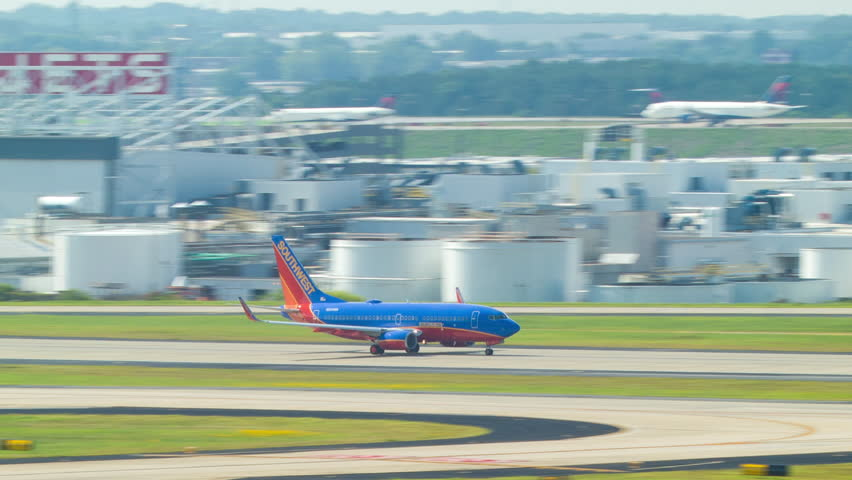 ATLANTA - 2014: Southwest Airlines Boeing 737 Taking Off into a Blue Sky from Hartsfield Jackson Atlanta International Airport ATL on a Sunny Morning.