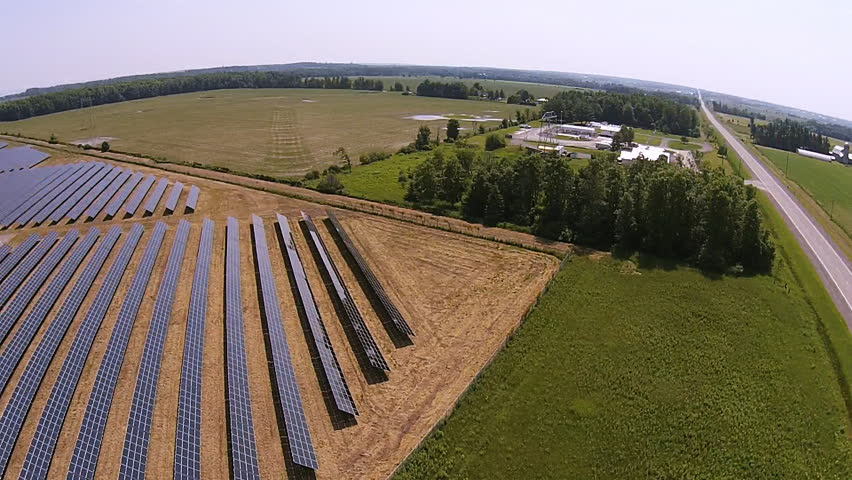 ONTARIO, CANADA - JUNE 1, 2014 : The Provincial Government of Ontario Has Introduced A Clean Energy Plan Which Has Created Investments By Business In Renewable Energy Like These Solar Panel Farms.