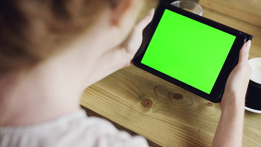 Green screen hands using digital tablet touchscreen device ipad in cafe