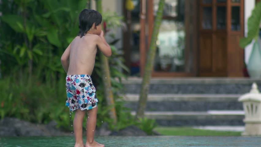 Boy nosediving in the swimming pool, slow motion shot at 240fps  - HD stock footage clip