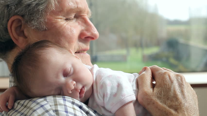Grandfather Holding Sleeping Newborn Baby Granddaughter | Shutterstock HD Video #7387966