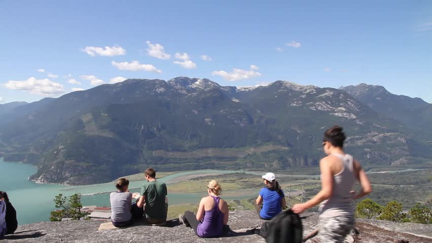 VANCOUVER, BC ,CANADA - CIRCA September 2011 :Squamish chief mountain - friends have lunch at top