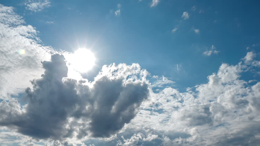 Spectacular sun bursting through clouds beautiful sky timelapse 4K UHD