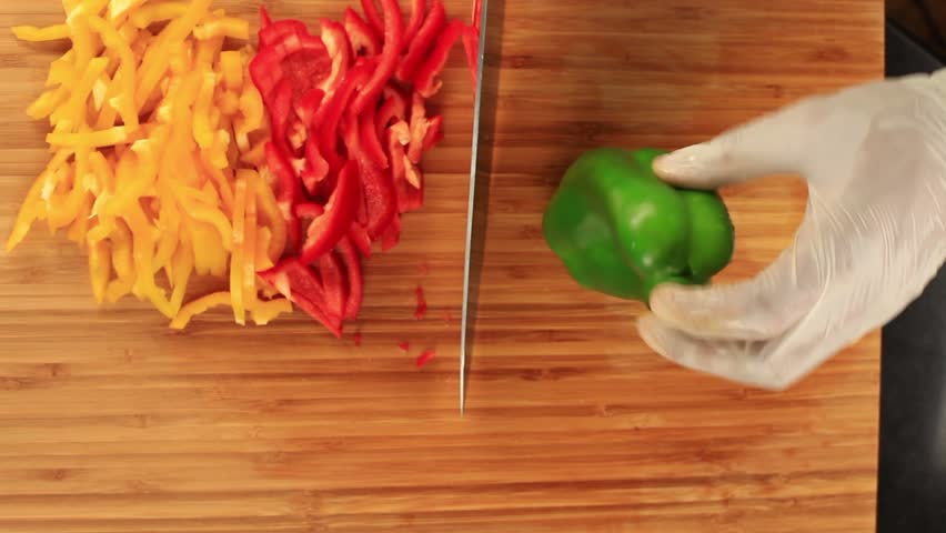 Cutting red pepper - Vegetables Presentation 1 - It s series of a small movies with some vegetables and cutting with gloves . date : 20.05.2014 location : Amman - Jordan - HD stock video clip